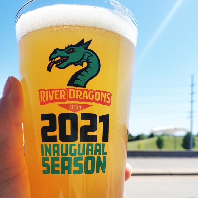 Glass of beer with River Dragons Alton logo followed by 2021 Inaugural Season